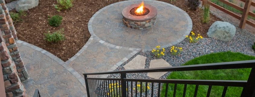 upstairs deck leading down to firepit on patio-all exteriors