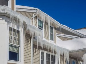 Ice Dam on House and in Gutters image